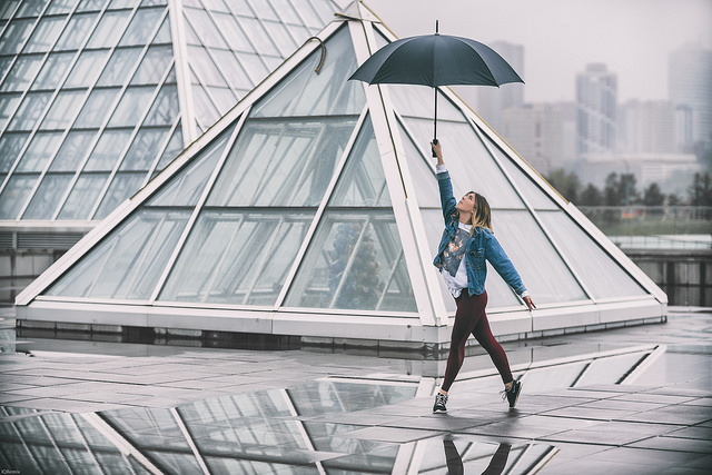 Girl dancing with an umbrella at Muttart Conservatory in Strathearn Edmonton